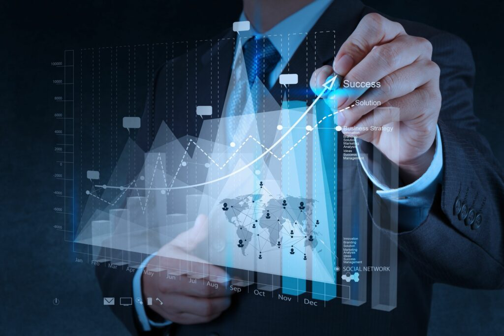 Man drawing on projected graph showing growth.